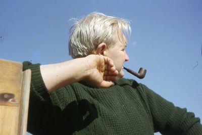 Eric Jones smoking a pipe