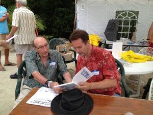 James and Scott examining a book