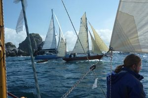 Amatasi sailing alongside other traditional boats