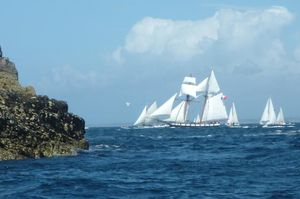 Rocky islets and sailing boats