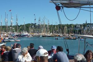 Crowds with boats in the background
