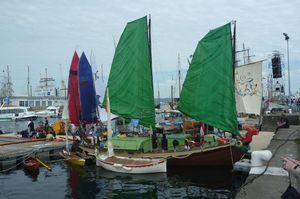 Vietnamese Junk boat with green sails