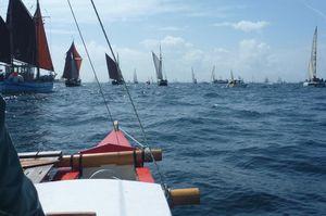 Amatasi sailing alongside other traditional boats