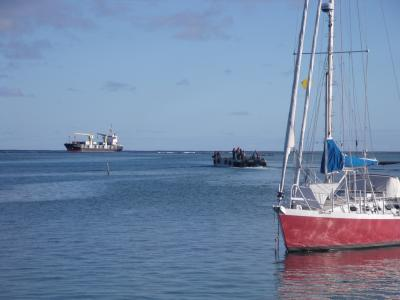 Supply freighter, barge and monohull yacht