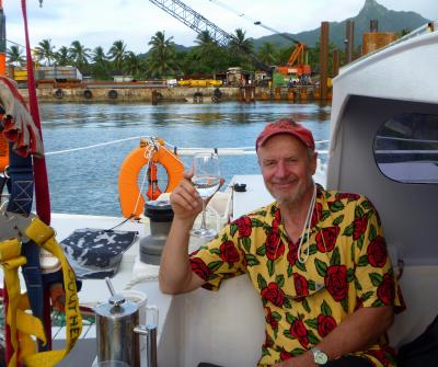 Don with a glass of drink aboard Katipo in harbour