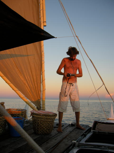 Matt Fletcher standing on deck at sunset