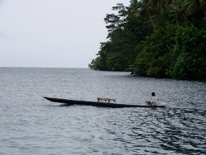 A local in an outrigger canoe