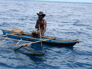 Local in an outrigger canoe