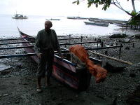 James with an outrigger canoe