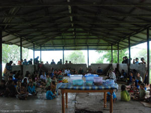 Many villagers gathered under a roof