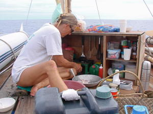 Hanneke cooking a meal on deck