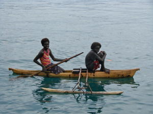 Local girls in an outrigger canoe