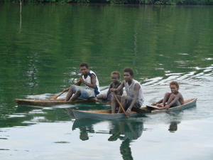 Locals paddling a double canoe