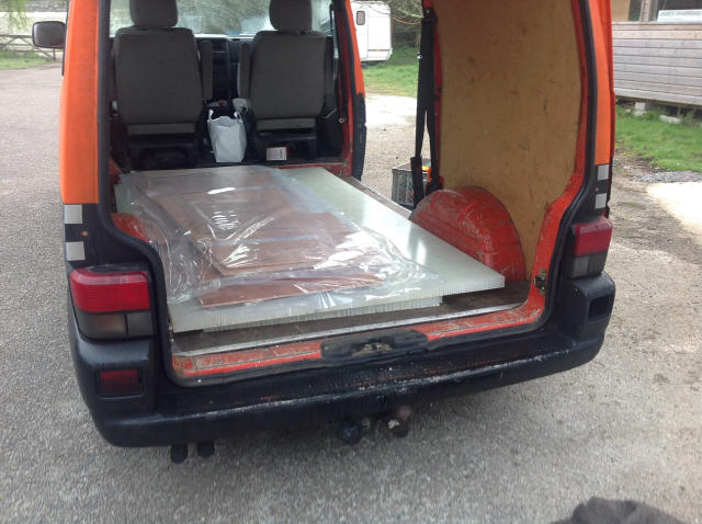 Van with tailgate open, plywood panels inside