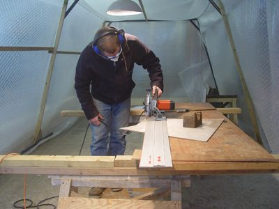 John using a plunge saw in the workshop