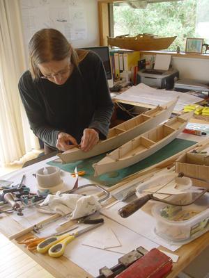 Hanneke building Amatasi model on a workbench