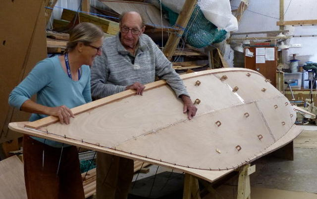 James and Hanneke inspecting a boat hull in a workshop