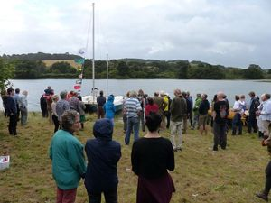 Many people gathered at Wharram HQ. Mana is on the water behind them.