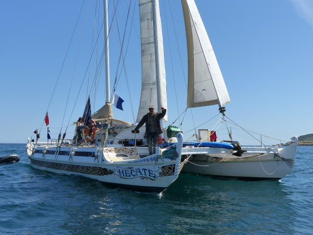 Pahi 52 Hecate with skipper Matt Knight standing on bow