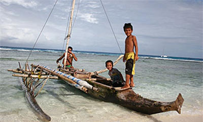 Traditional outrigger canoe of Anuta being used by native children