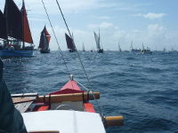 Amatasi sailing alongside other boats