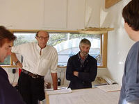 James having a discussion with visitors in the design studio