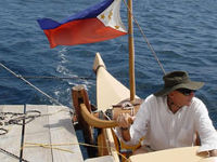 James Wharram at the helm of a Tama Moana