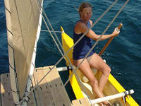 Hanneke at the helm of Tahiti Wayfarer