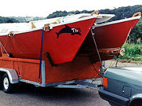 Tiki 21 being trailered by car