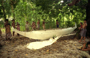 Many children with outrigger canoe