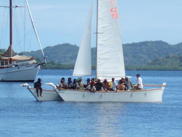 20 people on a Wharram double canoe sailing