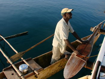 Roy in an outrigger canoe