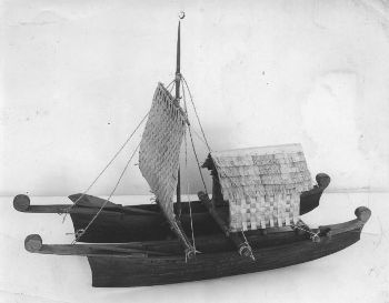 Double canoe model with sails and hut