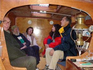 James and the French builders of a Tiki 46 sitting in the Peace IV galley.