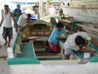 Boat builders at work