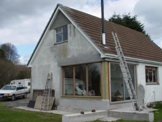 House with ladders leaned against it