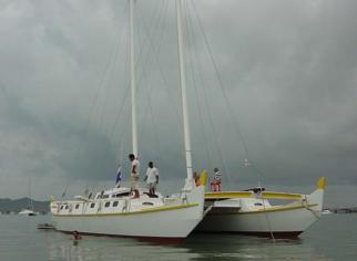 Large white and yellow catamaran