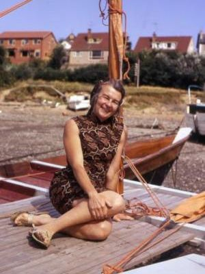Ruth Wharram on a beached catamaran