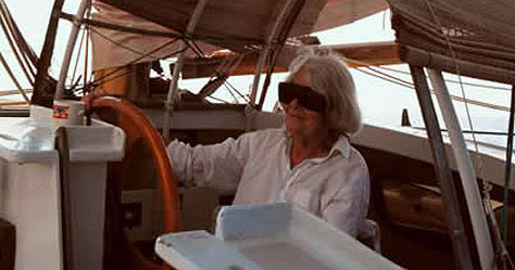 Ruth Wharram at the helm of Spirit of Gaia