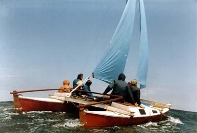 Sailing Tiki 21 with blue sail