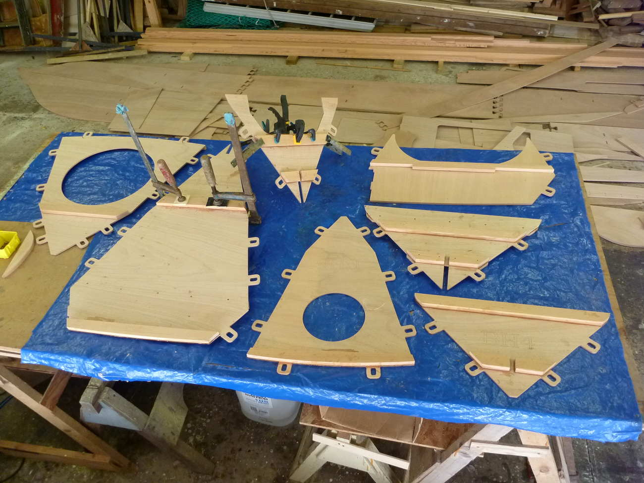 Mana 24 pre-cut plywood parts on a work bench