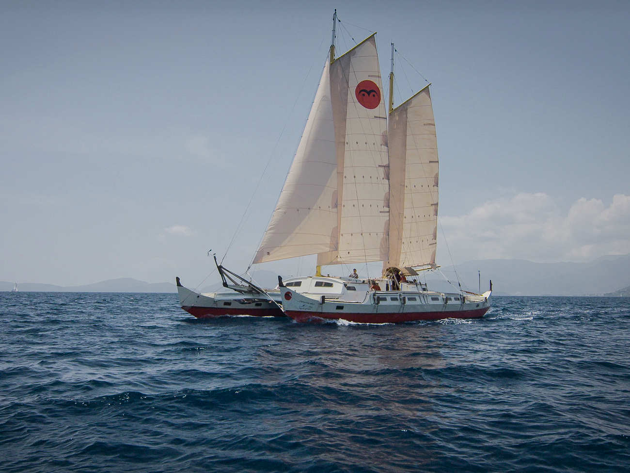 Distant photo of Pahi 63 Spirit of Gaia with all sails up