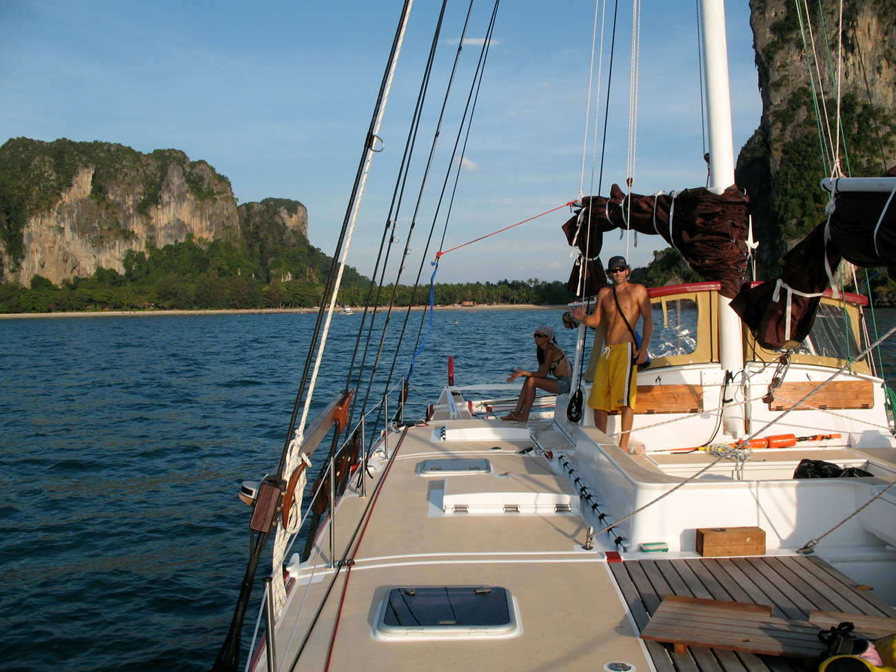 View from Pahi deck, two people aboard, dramatic landscape