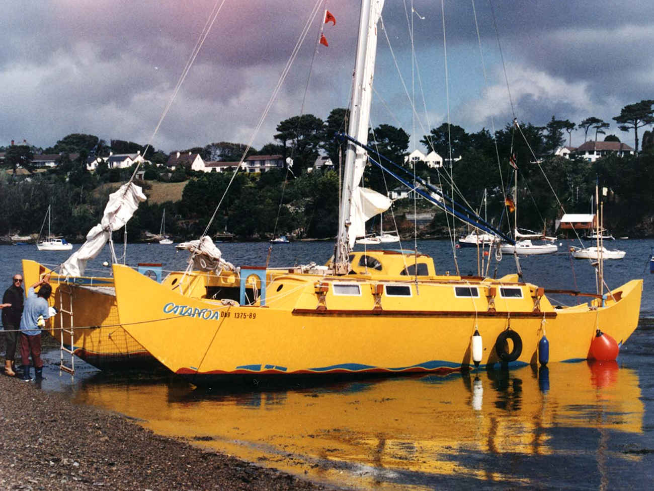 Yellow Pahi 42, beached in a harbour