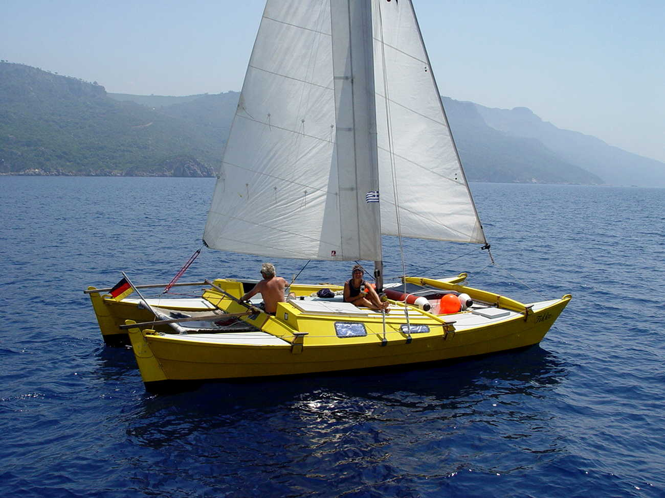 Yellow Tiki 26 sailing on crystal blue water