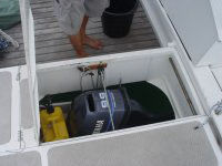 Outboard engine in box below deck