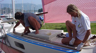 Hanneke and Michael working on a boat