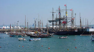 Many sailing ships in the harbour