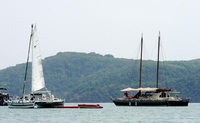Tiki 38 and Islander 55 on the water