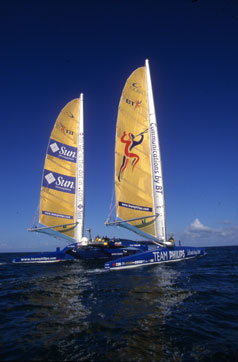 Racing catamaran, twin sails